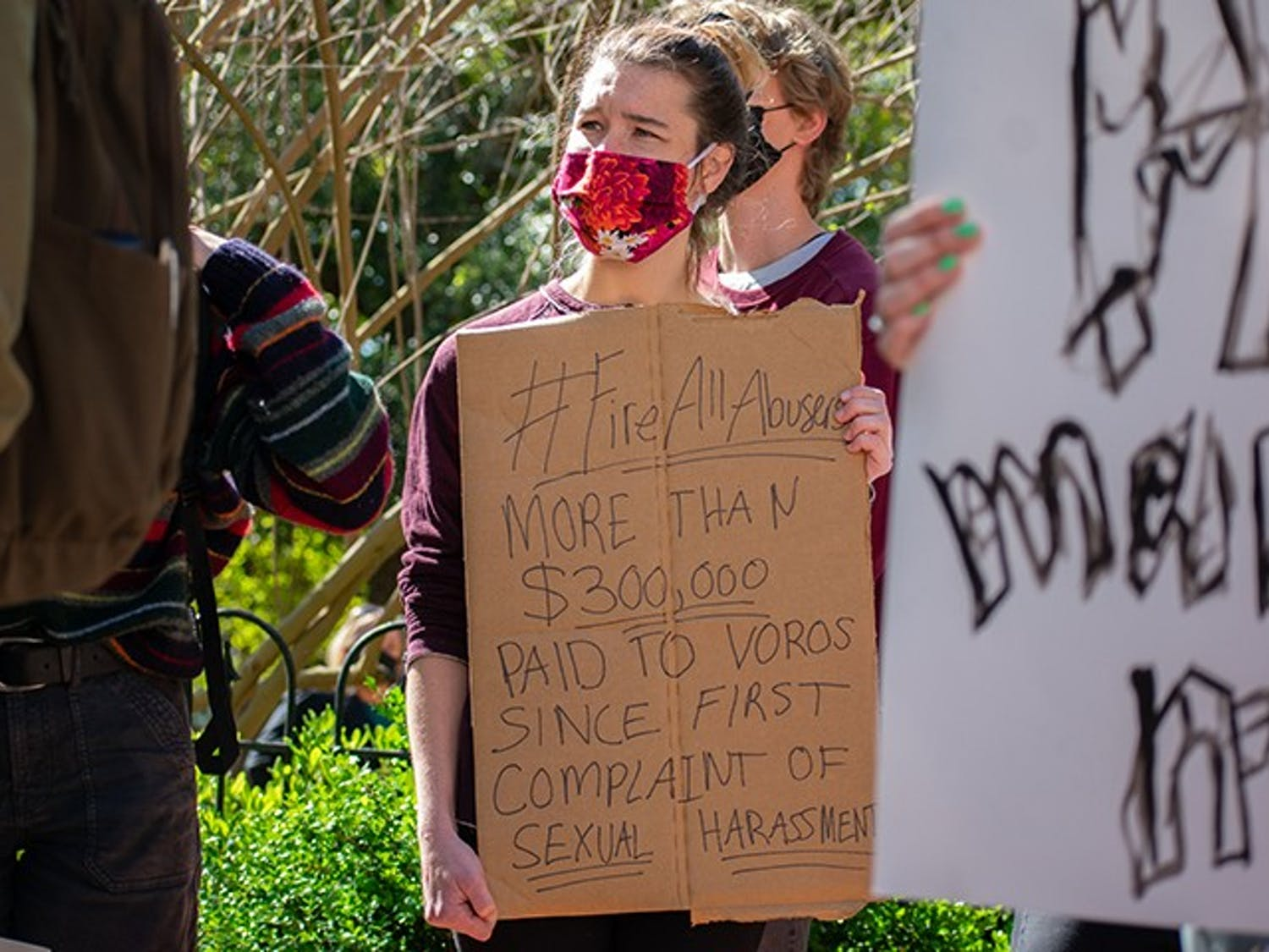 Students bring signs to protest the university's lack of response toward the numerous acts of sexual assault and violence committed by David Voros and several other staff members.