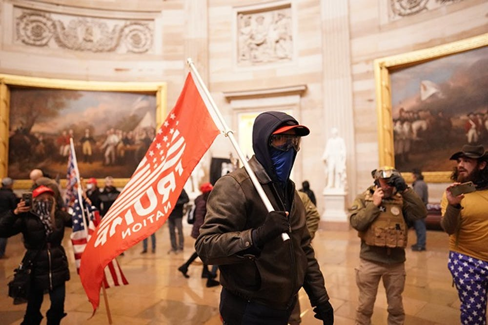 Protesters storm the Capitol and halt a joint session of the 117th Congress on Wednesday, Jan. 6, 2021, in Washington, D.C. (Kent Nishimura/Los Angeles Times/TNS)