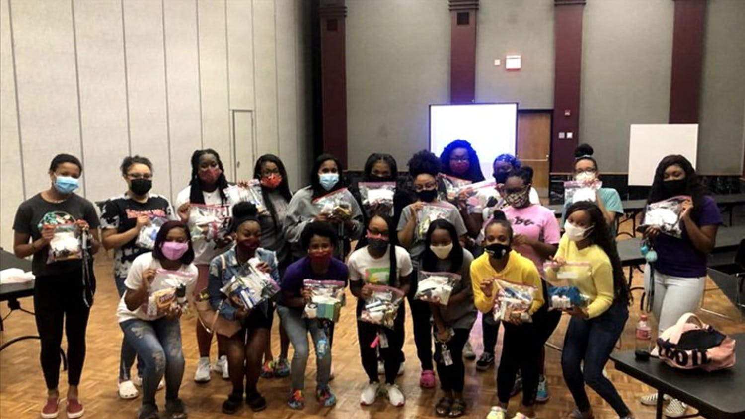 Members of SAVVY partner with Locked with Luv's breast cancer awareness event. The all-female multicultural organization provides many community service events throughout the year.