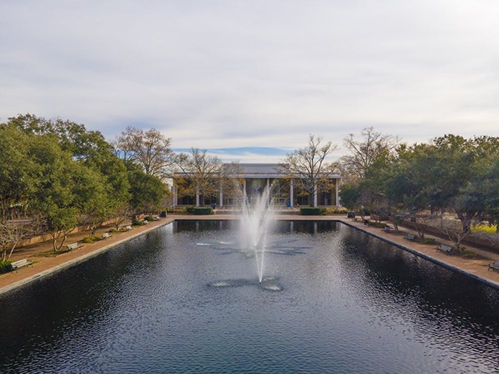 <p>Aerial shot of Thomas Cooper Library showing the reflecting pool, which has benches, often used as study spots, lining it.</p>