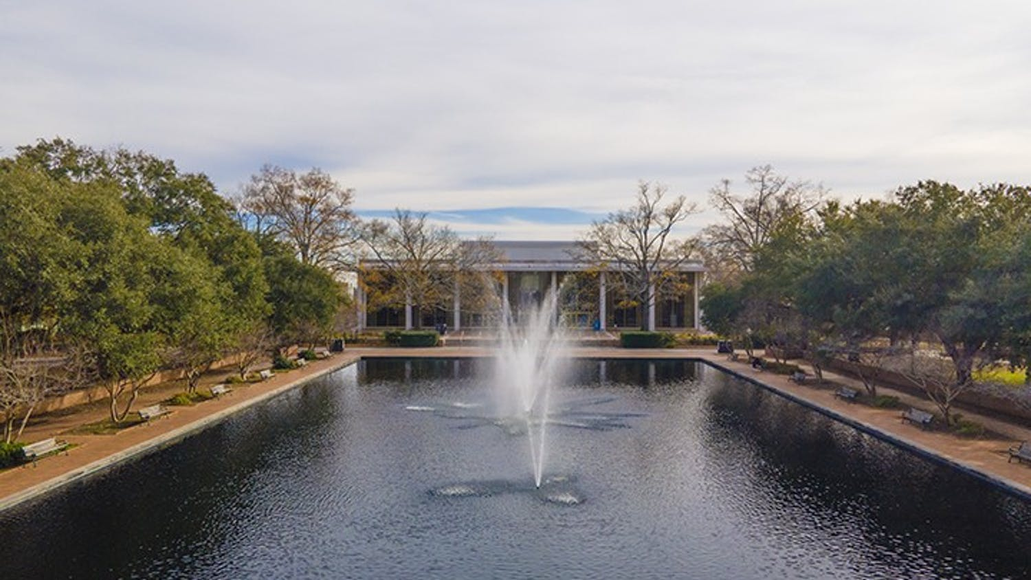 Aerial shot of Thomas Cooper Library showing the reflecting pool, which has benches, often used as study spots, lining it.