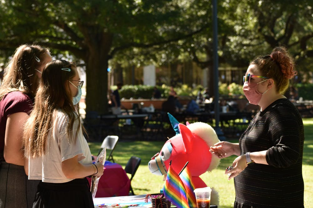 Students receive information about the LGBTQ+ History Month Kick-Off. The kickoff happened on Davis Field Thursday.