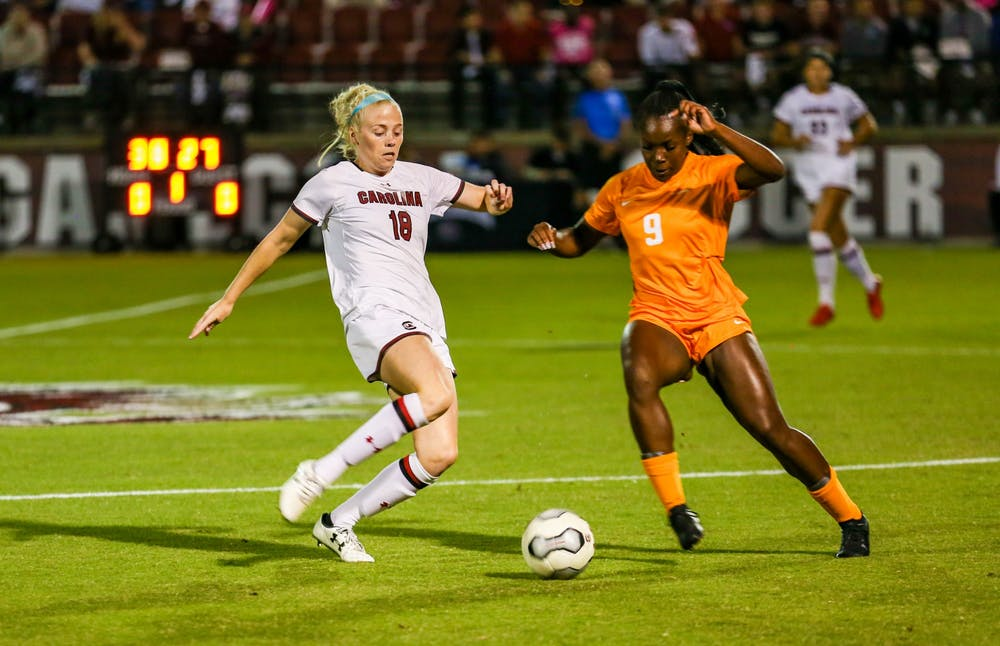 <p>Defender Grace Fisk dribbles around a defender in a game during the 2019 season against Tennessee. The Gamecocks lost 1-0 to the Volunteers on Friday.</p>