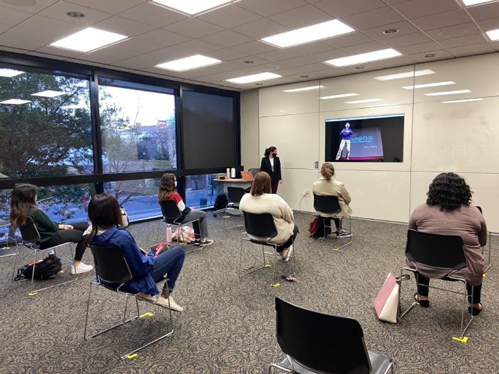 <p>Parker Massignan, third-year international business and economics student and vice president of Women LEAD, speaks during a meeting.</p>