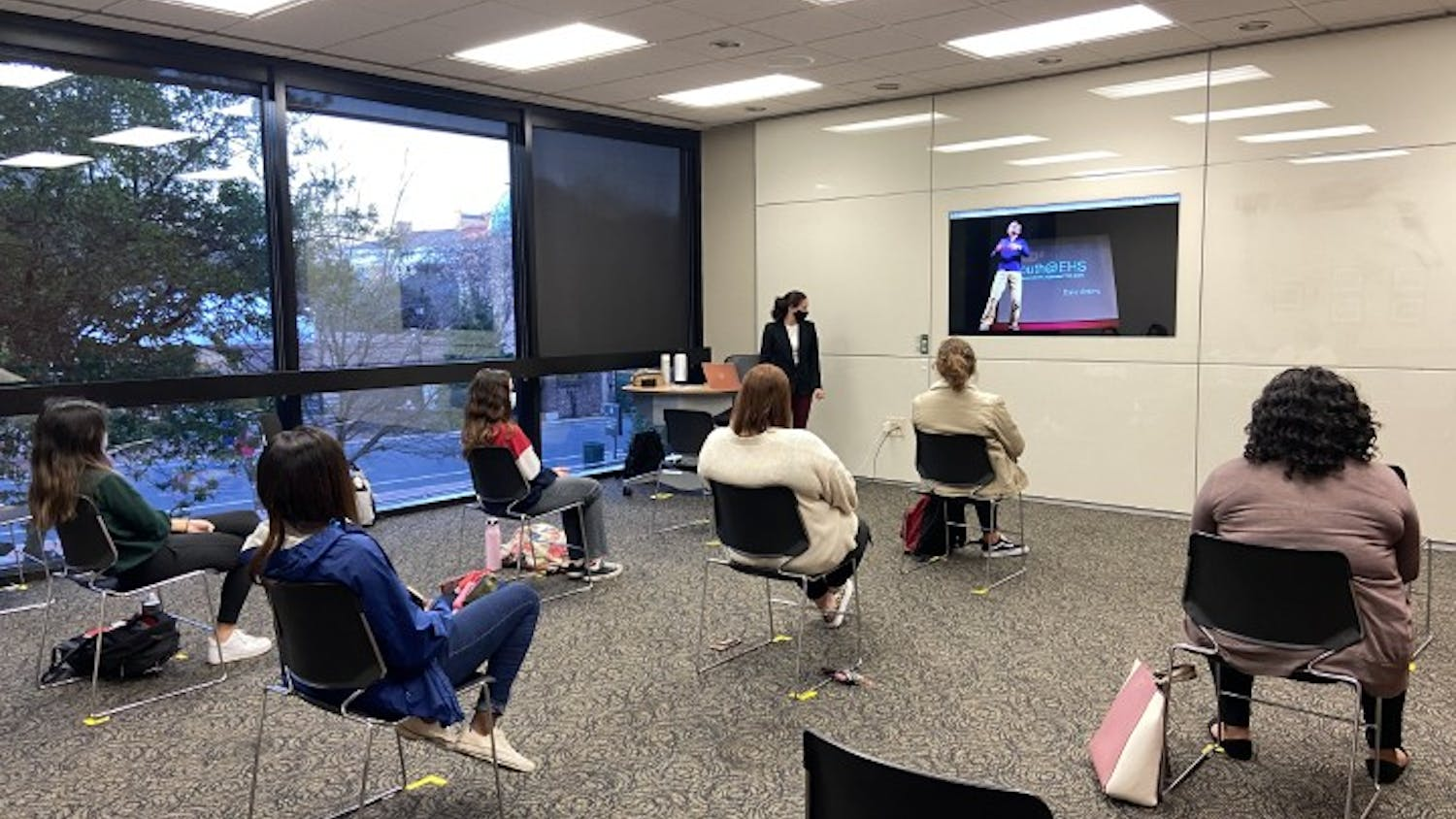 Parker Massignan, third-year international business and economics student and vice president of Women LEAD, speaks during a meeting.