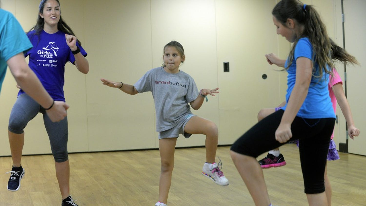 Nine-year-old Shoshanna Faerman, center, gets in her calisthenics workout on Sunday, Feb. 22, 2015. To fight obesity and improve girls' self-confidence, Girls on the Run meets every Sunday at B'nai Torah Congregation in Boca Raton, Fla. It's part of a national organization that encourages teamwork, physical fitness and positive attitudes for girls from eight to 13. (Scott Fisher/Sun Sentinel/TNS)