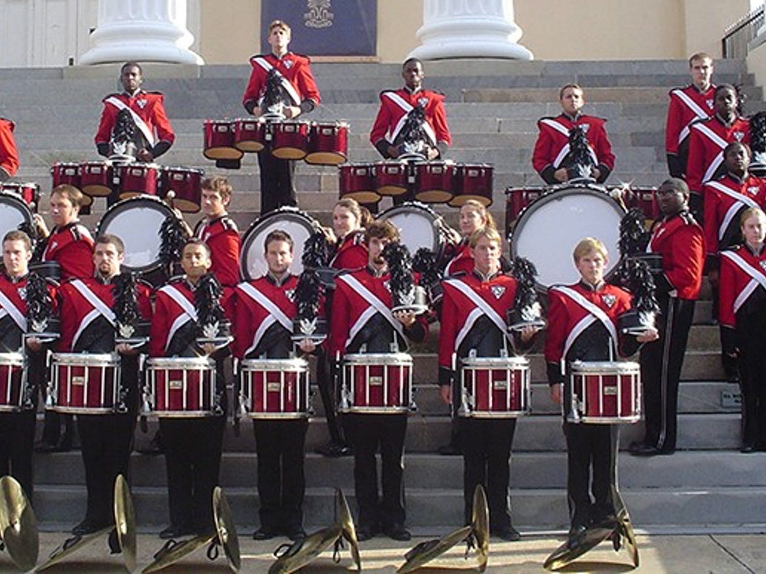 The 2004 Carolina Band drumline stands together at the steps of the Longstreet Theatre.