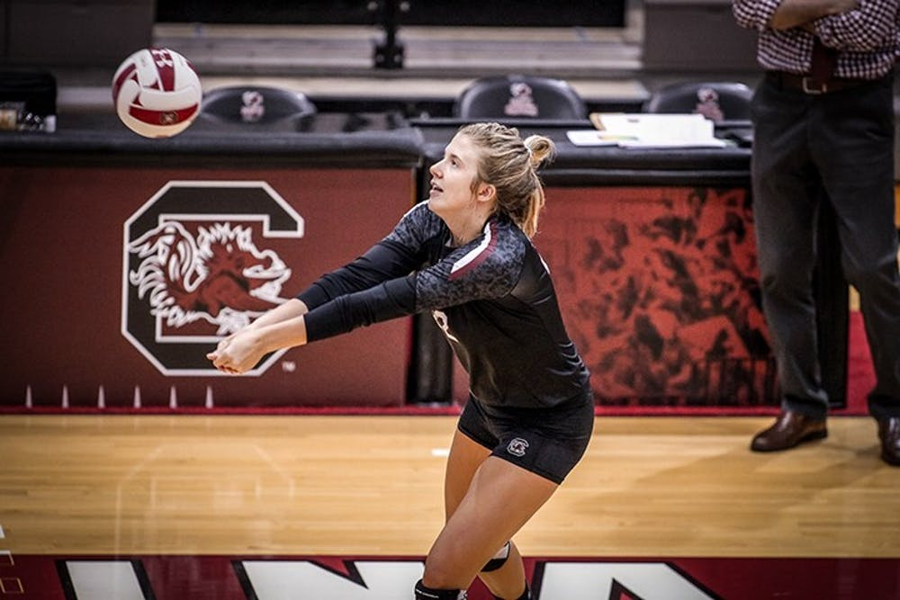 <p>Redshirt sophomore Courtney Weber goes for a pass during practice. The Gamecocks will play with a shortened schedule this season.</p>