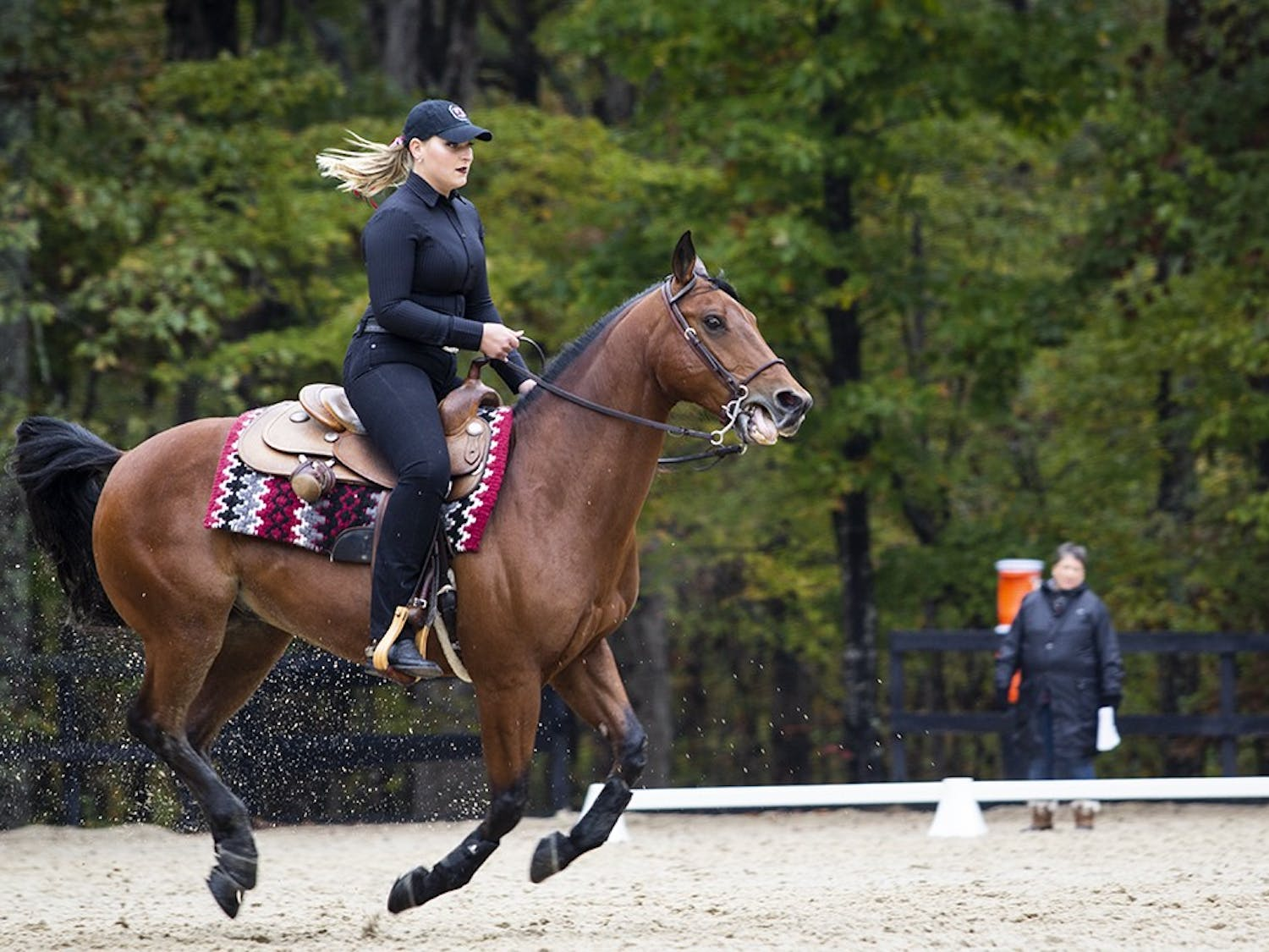 South Carolina sophomore Sloane Vogt riding on Magnum riding during their reigning event. Vogt scored a 67 on her ride.