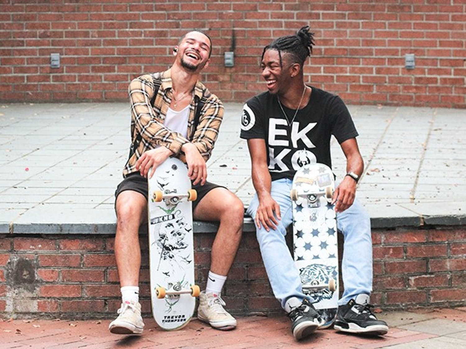 Second-year computer science student Andrew Dhillon, president of the Gamecock Skate Club, sits next to second-year computer engineering student Ta'Rajay Bowie, the vice president. Club members often skate outside Russell House and together have formed a community promoting health and unity through skateboarding.