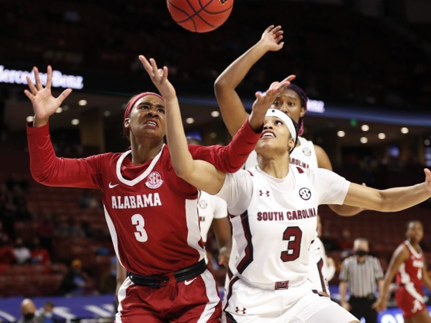 Junior guard Destanni Henderson fights for a loose ball in the South Carolina's win over Alabama Friday. The Gamecocks will play Tennessee Saturday for the SEC tournament semifinals.
