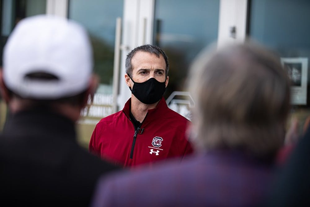 <p>Head coach Shane Beamer speaks to a crowd outside the football practice facility in December of 2020.&nbsp;</p>