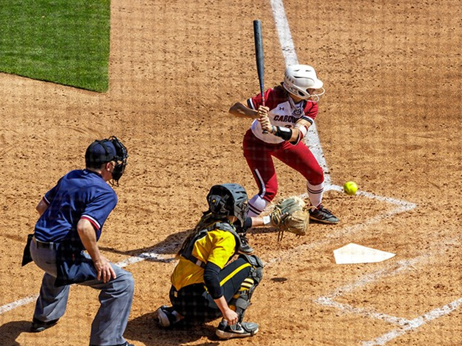 Graduate infielder Kenzi Maguire prepares to receive the ball from the Missouri pitcher.