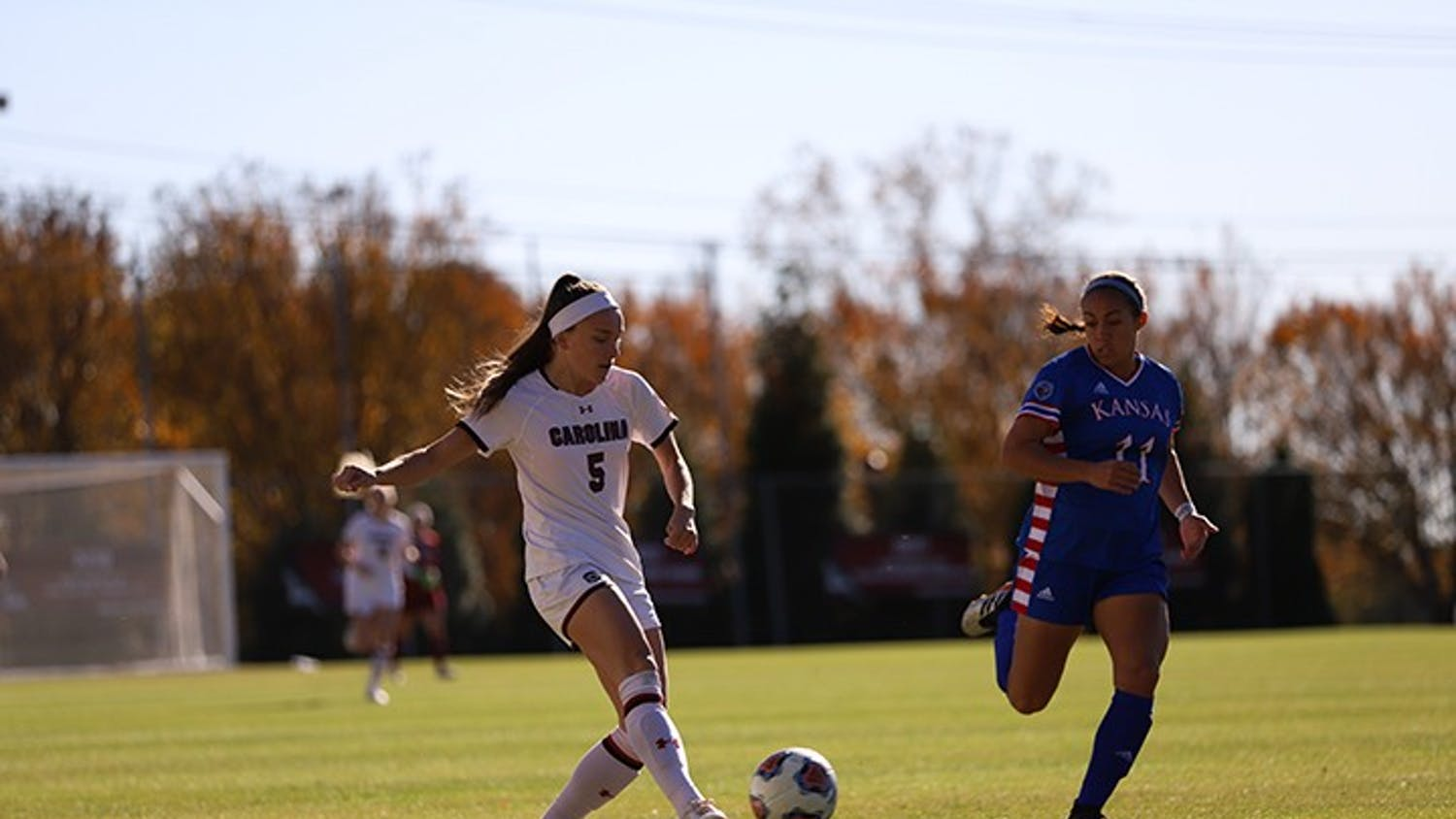 Senior forward Luciana Zullo dribbles the ball as a Kansas player runs beside her. Zullo tied in 9th place for NCAA Tournament points in a career with four.