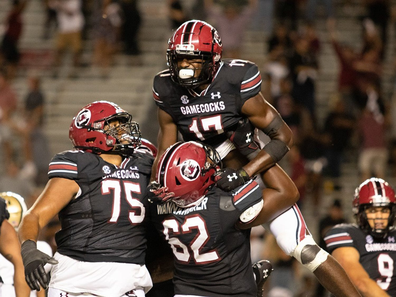 Gamecock football players celebrate junior wide receiver Xavier Legette after he caught the winning touchdown pass. The Gamecocks defeated the Vanderbilt Commodores with a touchdown in the fourth quarter.