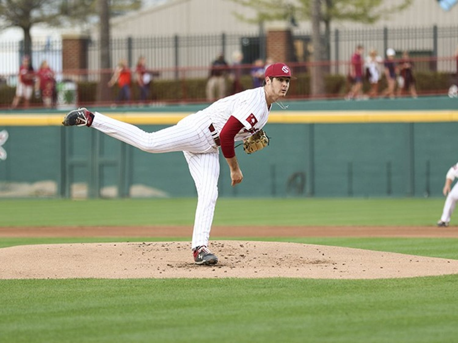 Freshman Daniel Lloyd pitches the ball during the Friday night game against Auburn at Founders Park.