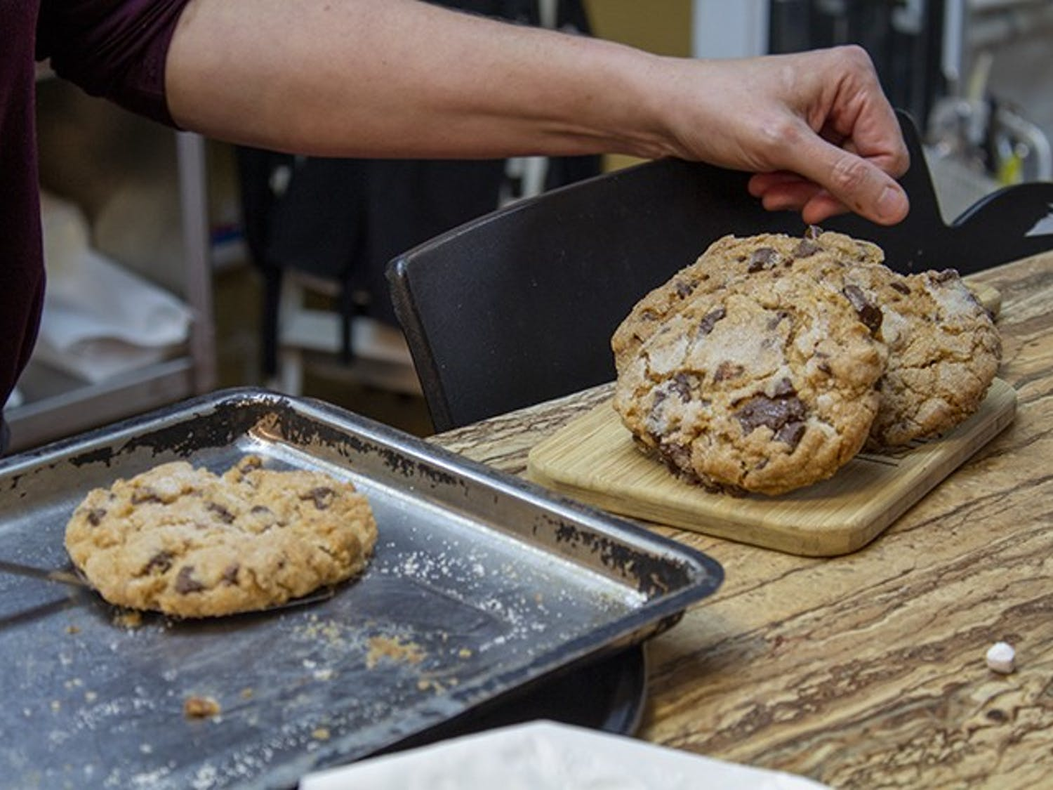 The Local Buzz owner Stephanie Bridgers prepares freshly baked, gluten-free lavender chocolate chip cookies to be sold. The Local Buzz is located on Harden Street in Five Points.