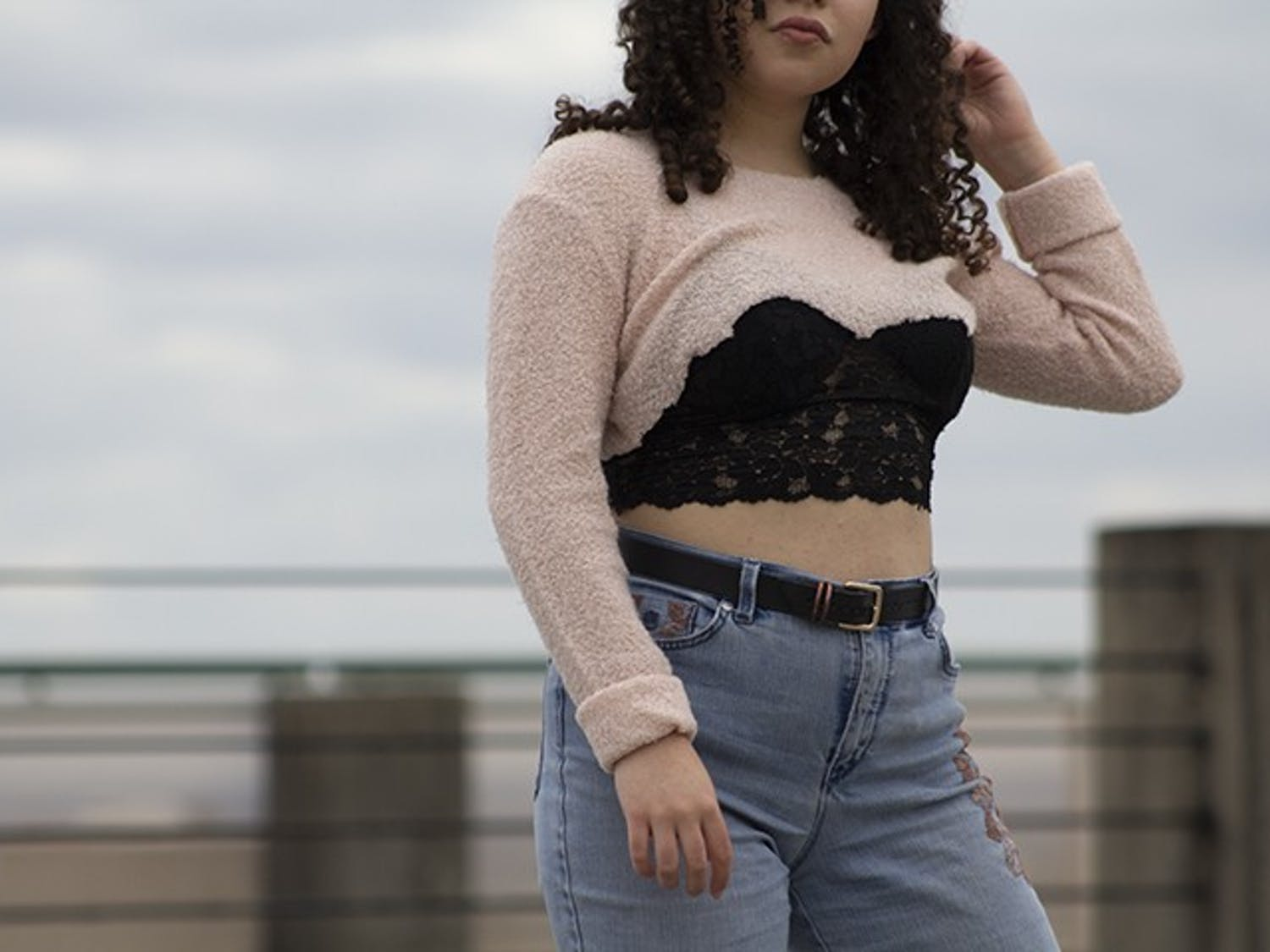 Wearing lace bralettes became a popular trend within the last four years and can be styled in a variety of ways, one being under thrifted sweaters with baggy pants and a belt.