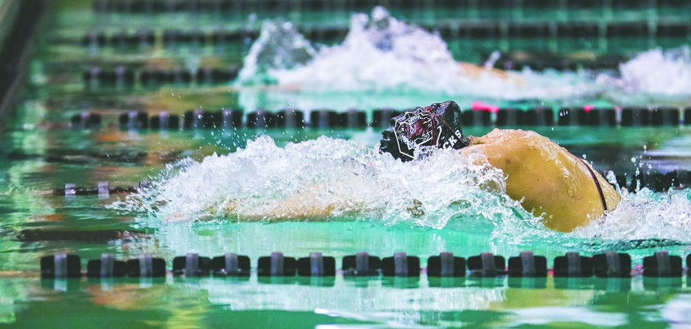 <p>A member of the swim team finishes a lap during the 2020 season. Swim and dive head coach McGee Moody and South Carolina have mutually agreed to part ways.</p>