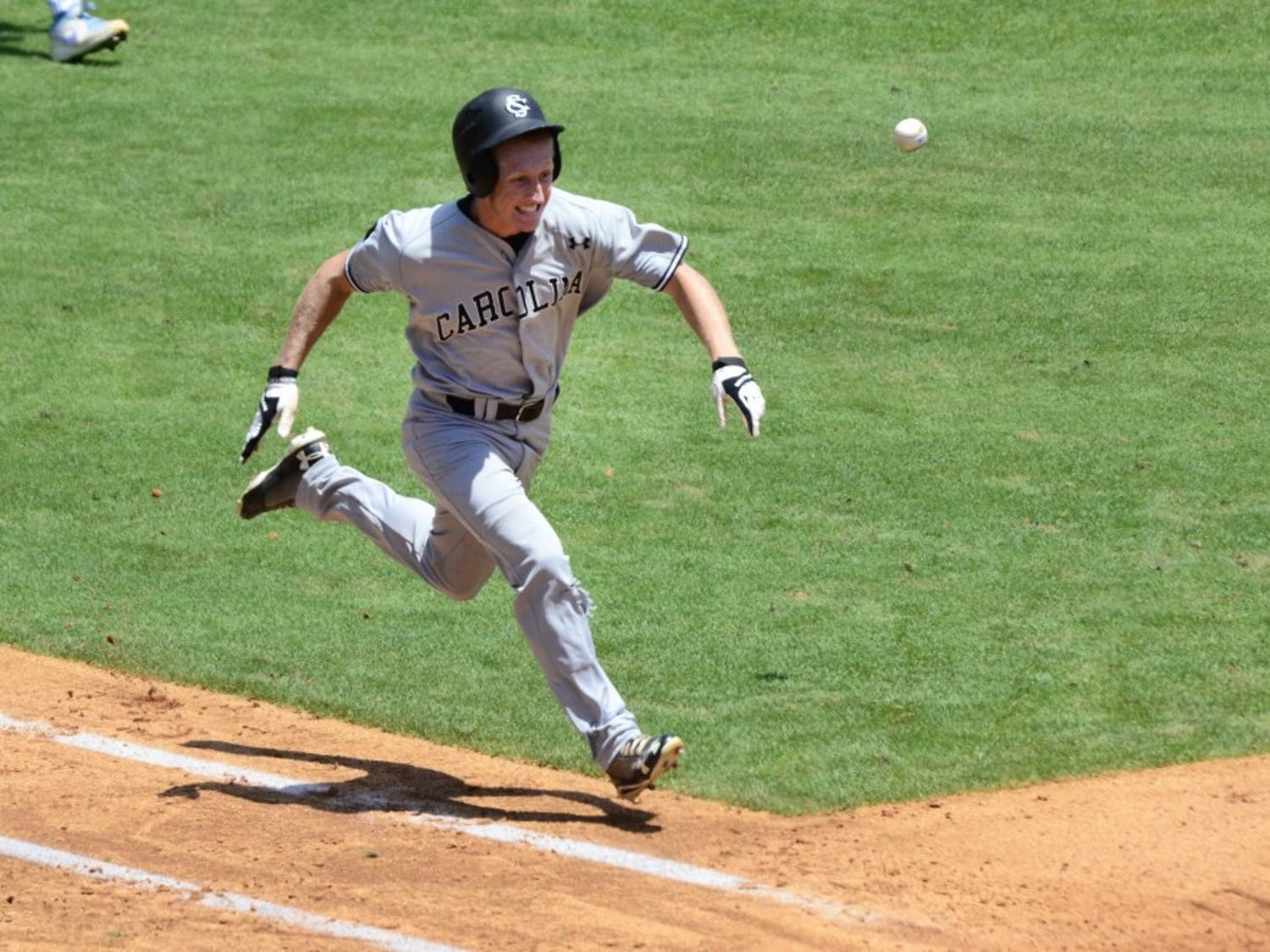 Tanner English races the ball to first base after a bunt.