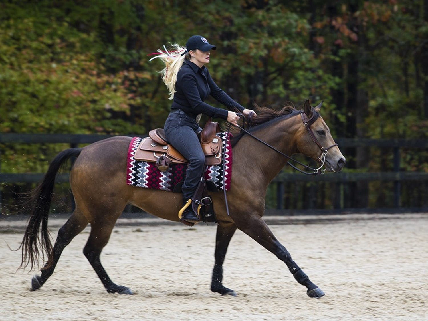 South Carolina senior Caroline Gute riding on Stoner during their reining event. Gute scored a 70.0 on her ride.