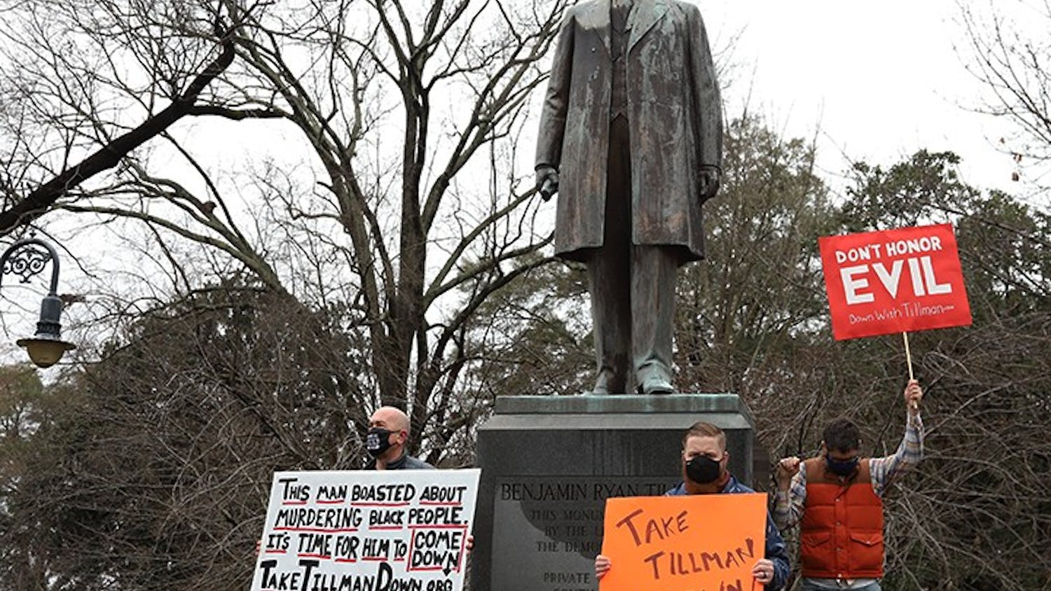Protesters stand in front of the Benjamin Tillman statue at the South Carolina Statehouse. The protesters are calling for the removal of the statue based on Benjamin Tillman's history.