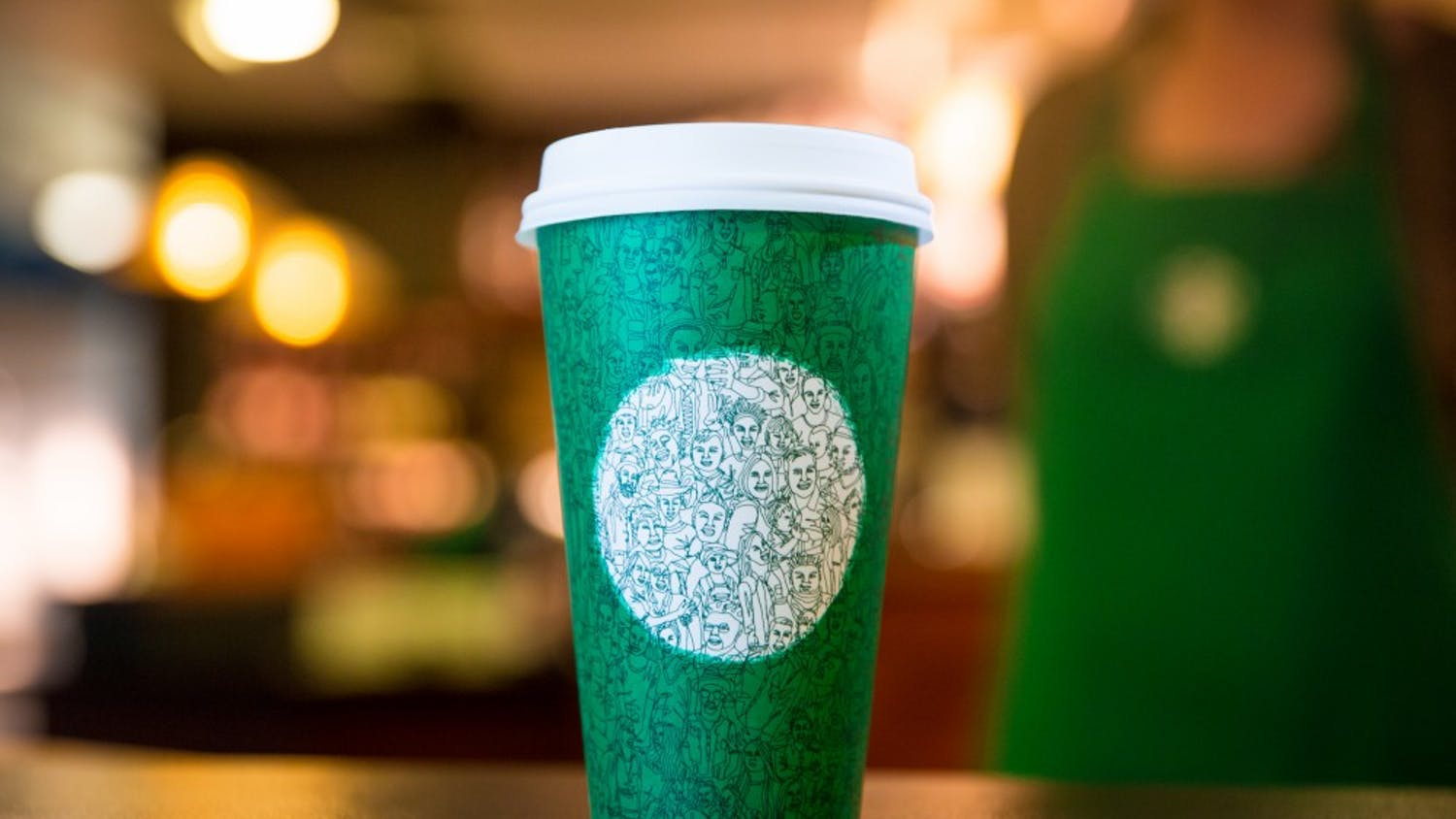 The illustration on the green Starbucks cup was drawn in one continuous stroke.