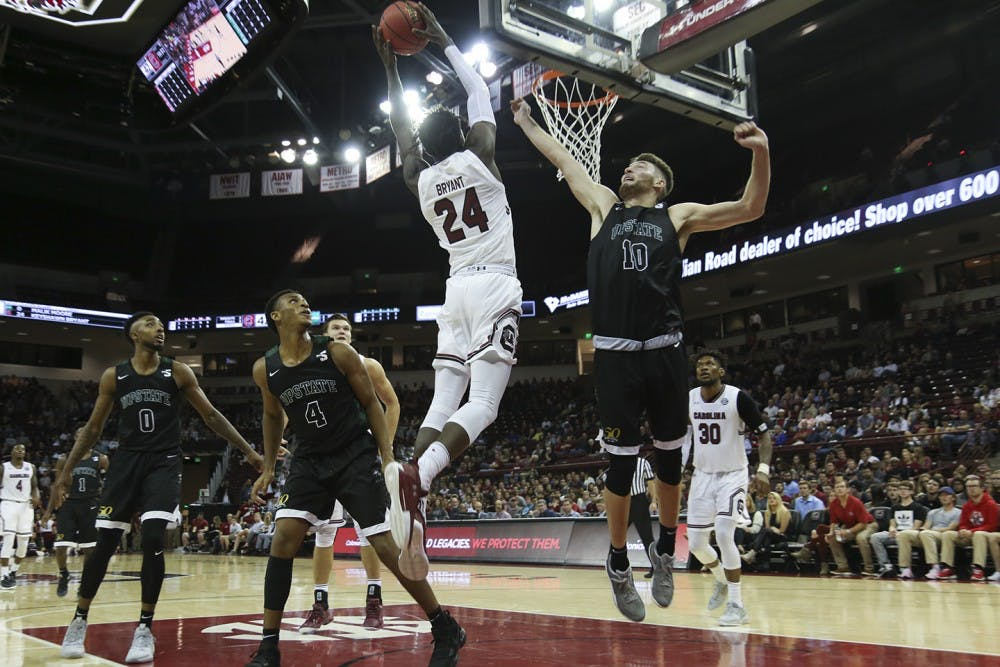 <p>Senior Keyshawn Bryant jumps for a layup. Bryant is one of the returning players on the team, who will be playing alongside 9 new members of the mens basketball team this season.&nbsp;</p>