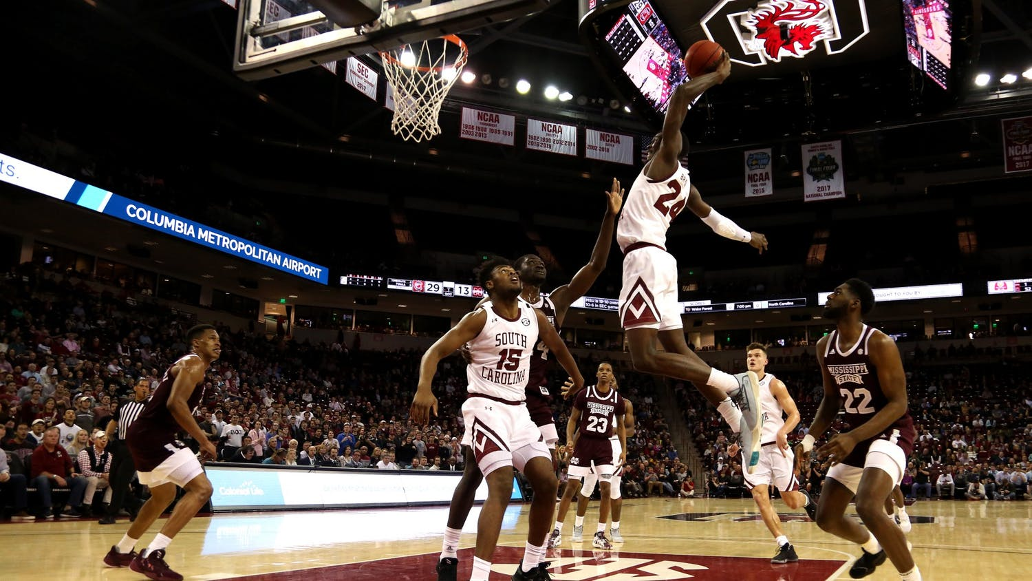 Sophomore forward Keyshawn Bryant dunks the ball during the game against Mississippi State on March 3, 2020.