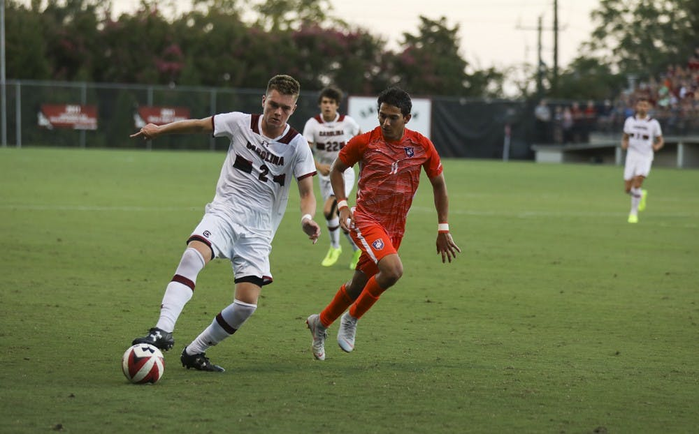 <p>Midfielder Mitchell Myers dribbles in a game against Clemson in 2018. The Gamecocks host the Tigers Thursday night at Stone Stadium.</p>