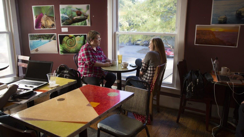 Kathy Seppamaki and Rachel Rizzuti enjoy coffee at Cool Beans.