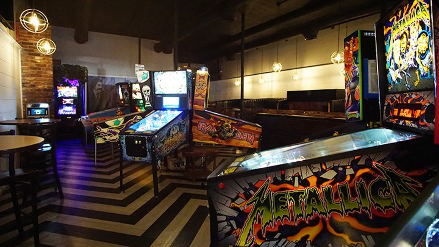 """Pinball machines with pop culture themes fill Bang Back Pinball Lounge. The """"barcade"""" also has an indoor food truck, where customers can order from a range of different cuisines."""