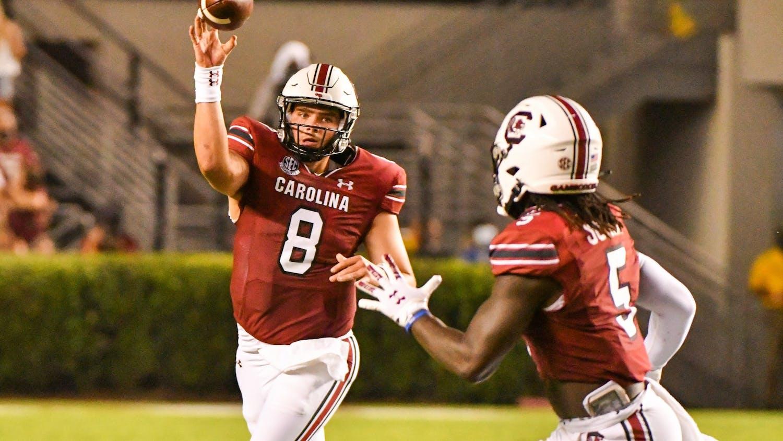 Graduate quarterback Zeb Noland throws a pass to the wide receiver Dakereon Joyner