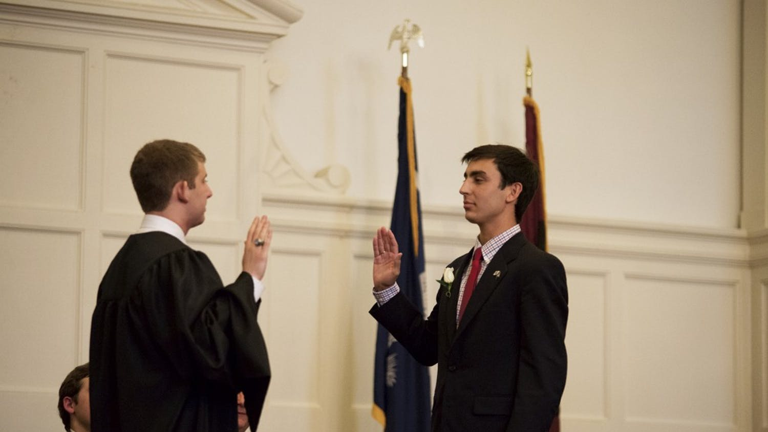 Kaufman, right, being inaugurated to the office of the presidency by Chief Justice Ross Abbott, left. The impeachment charges allege that Kaufman did not fill the post of Elections Commissioner within two weeks of his inauguration.