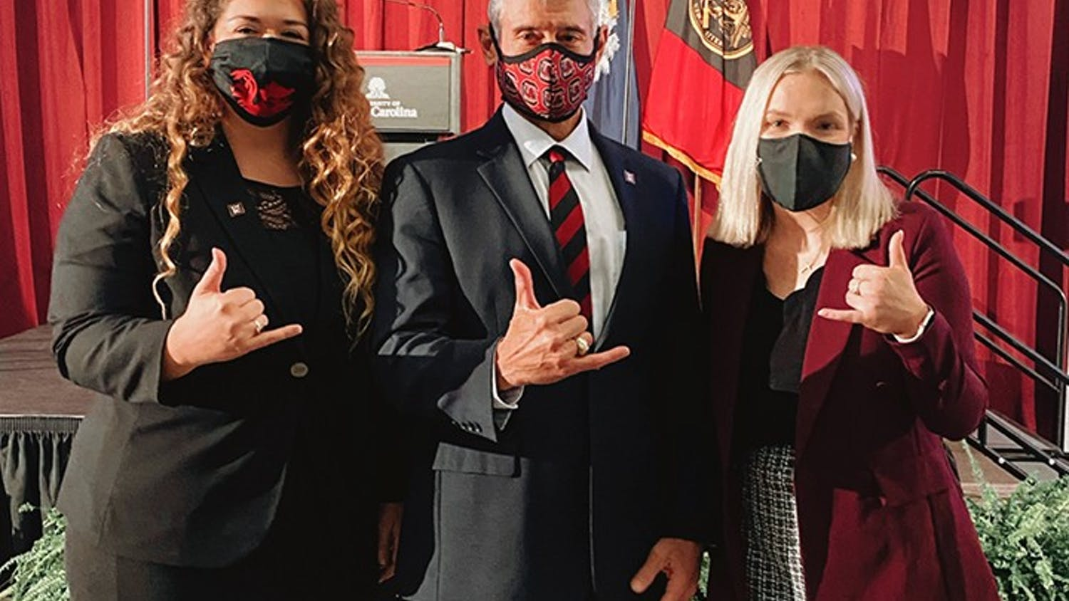 Issy Rushton, USC's student body president for the 2020-2021 school year, and Maggie Carson, president of the Graduate Student Association, stand with university President Bob Caslen.