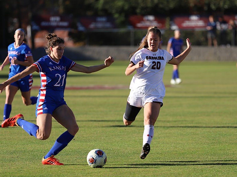 Redshirt sophomore midfielder Samantha Chang runs to defend a Kansas player in 2019.