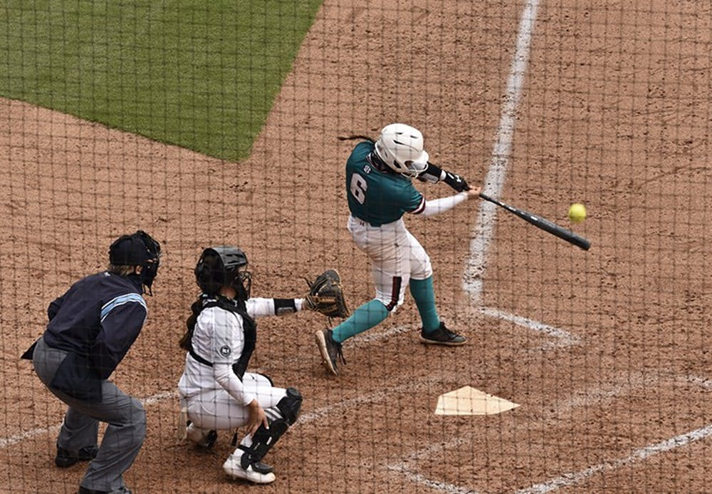 """<p>Junior catcher Jordan Fabian connects on a pitch in Sunday's game against the University of Central Florida. The Gamecocks wore teal for """"All for Alex,"""" which is an organization that aids in the fight against ovarian cancer.&nbsp;</p>"""