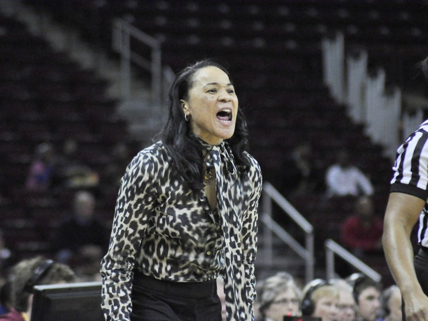 USC women's basketball coach Dawn Staley announced Sunday night she withdrew her name from consideration for the Ohio State head-coaching vacancy.