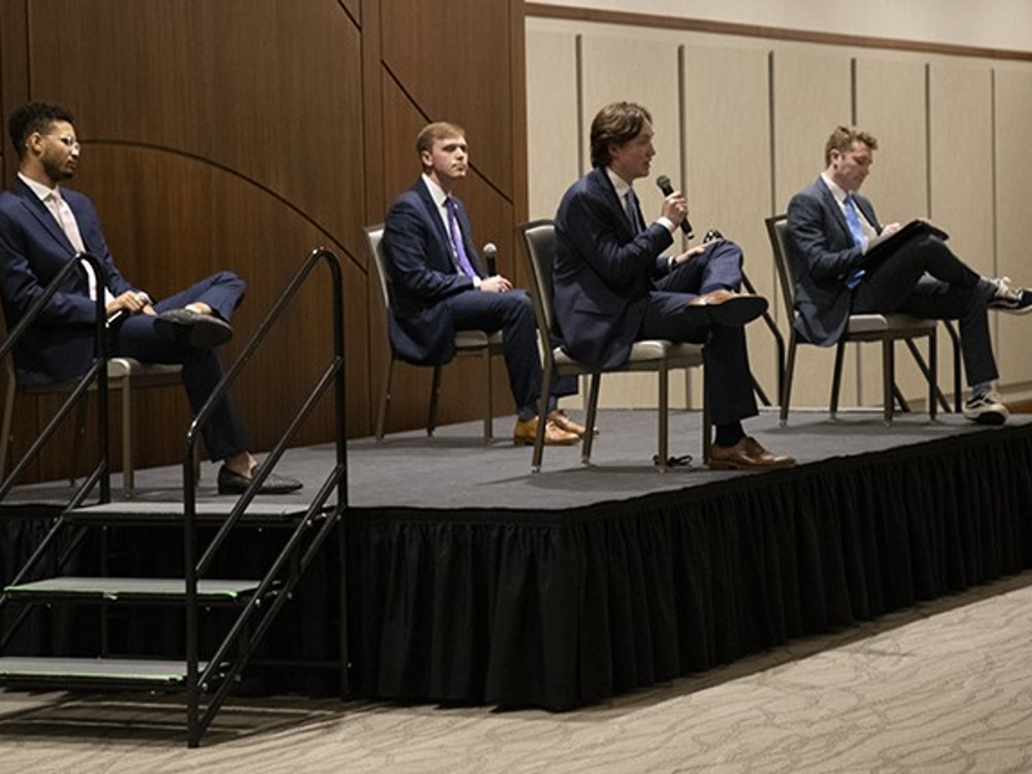 Student body president candidates (from left to right) Aidan Baker, Alex Harrell and Cameron Butler listen to Caden Askew's answer to a question. The candidates were asked a series of general questions, individual questions and questions pulled from social media.