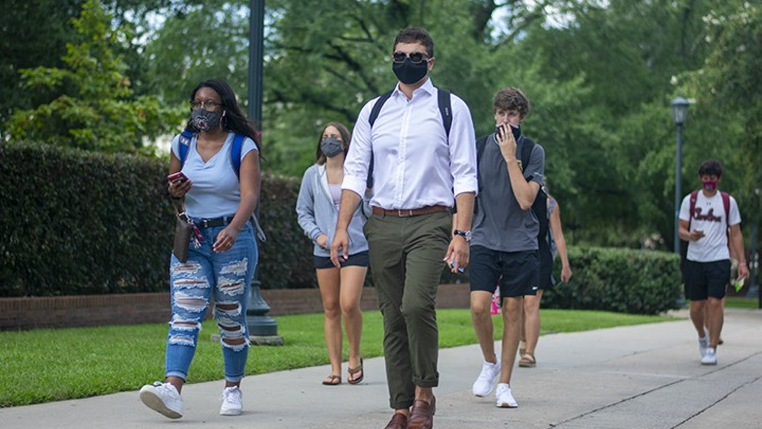 USC students walk down Greene Street with masks on. Wearing masks on campus became part of many students' daily lives in the 2020-2021 school year.