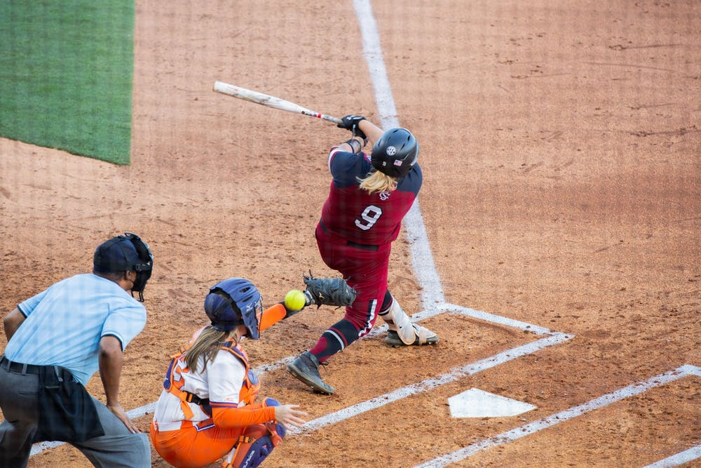<p>&nbsp;Graduate student pitcher Cayla Drotar swings at the ball pitched by Clemson's pitcher.&nbsp;</p>