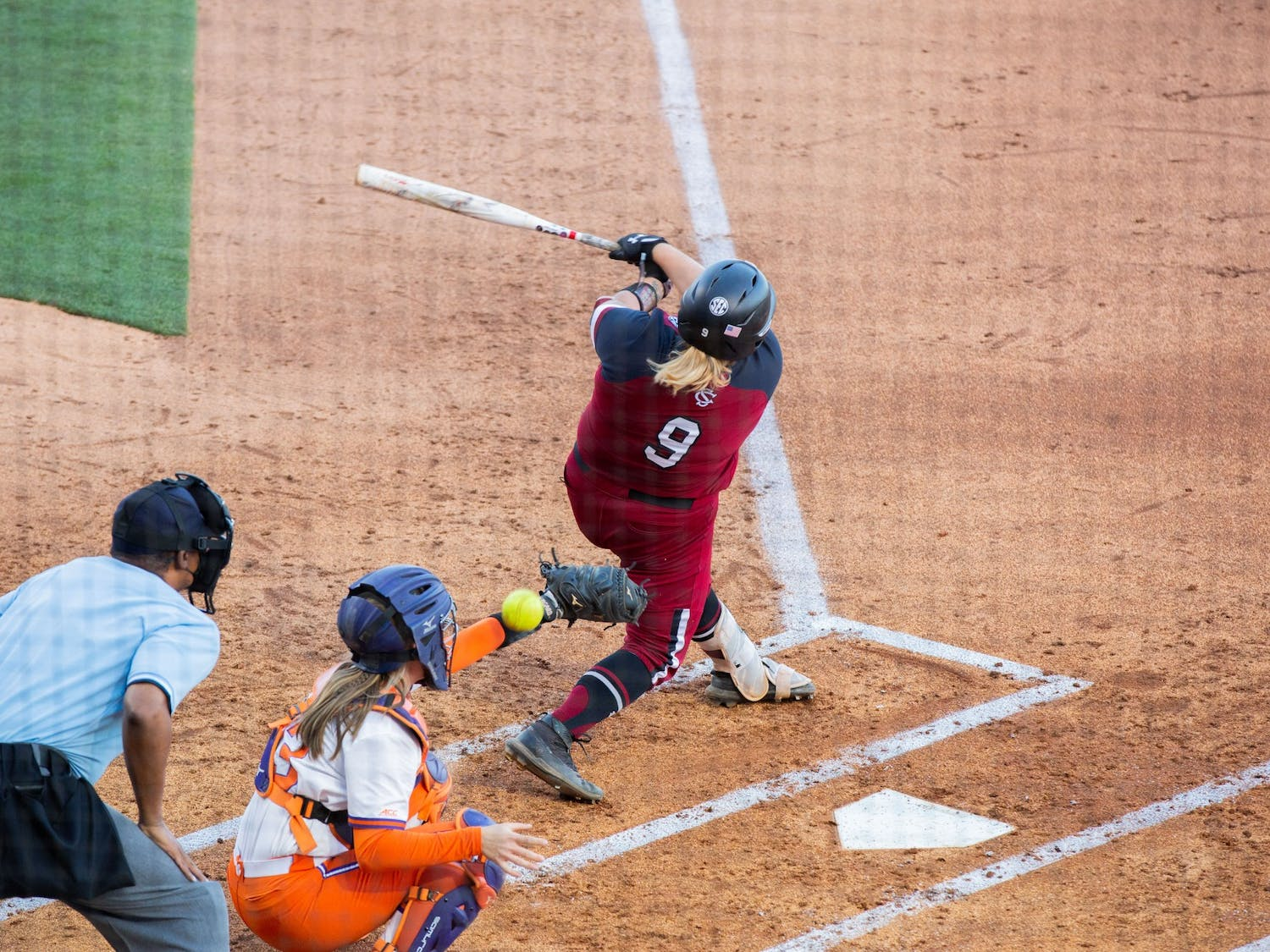 Graduate student pitcher Cayla Drotar swings at the ball pitched by Clemson's pitcher.