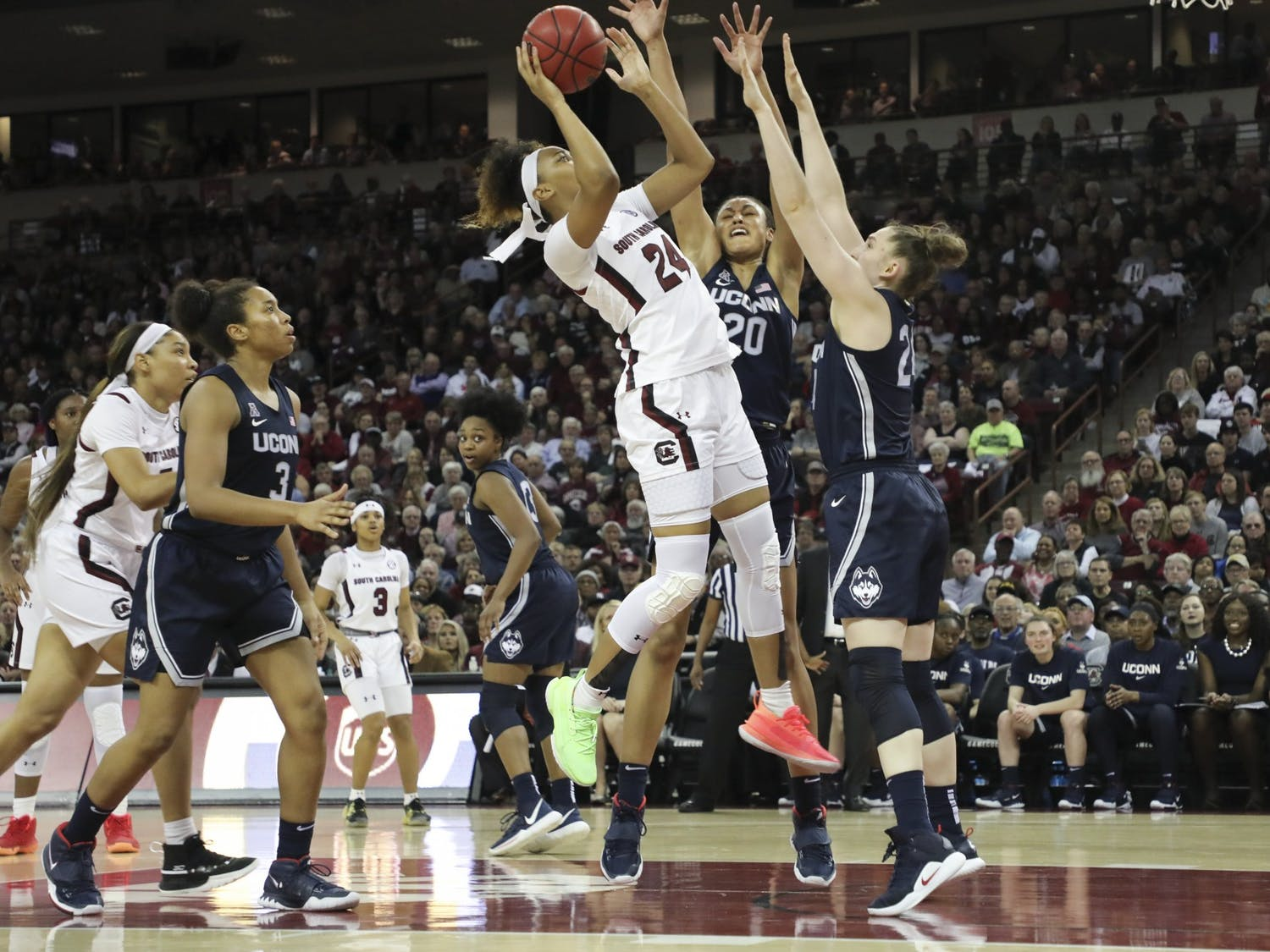 Junior guard Lele Grissett goes up for a shot while UConn players attempt to block her. Grissett scored 2 points against the Huskies.