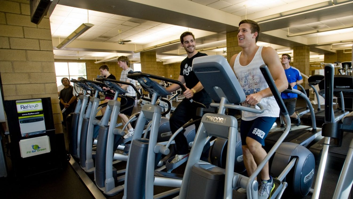 Instructor Kevin Brostoff, left, and student Jared Olivo generate electricity as they workout on elliptical trainers at at the Anteater Recreation Center at the University of California, Irvine, on January 20, 2012. Using gym equipment, Fit for Green makes a game out of the creation of renewable energy in the gym, using social media as a platform. (Paul Rodriguez/Orange County Register/MCT)