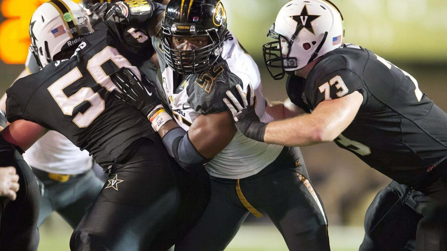 Missouri Tigers defensive lineman Michael Sam, center, on Sunday, Feb. 9, 2014, became the most prominent, and apparently the first, active male athlete on the major U.S. sports scene to publicly disclose that he's gay. Sam is seen during a college football game against Vanderbilt in this October 5, 2013, file photo. (David Eulitt/Kansas City Star/MCT)