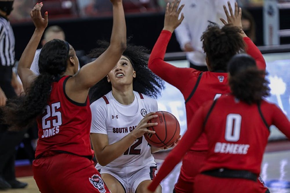 Sophomore guard Brea Beal looks to shoot over two defenders in the Dec. 3, 2020, loss to NC State. The loss ended a 29-game win streak by South Carolina.