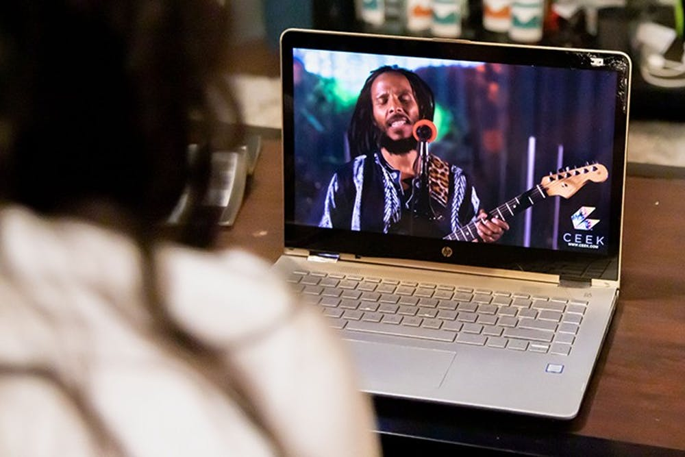<p>&nbsp;A person sits on their couch while streaming a concert on their laptop. Live-stream concerts became popular during the COVID-19 pandemic as they provided a safe way to attend and enjoy music entertainment.&nbsp;</p>