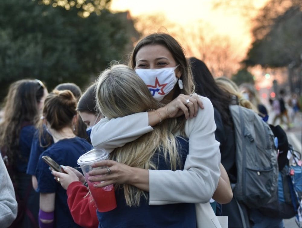 <p>Candidate for treasurer, Kate Turner (right), embraces the new student body vice president-elect, Emily Dengler, after the announcement of the Student Government election results. The presidential and treasurer elections will go on to a runoff.</p>