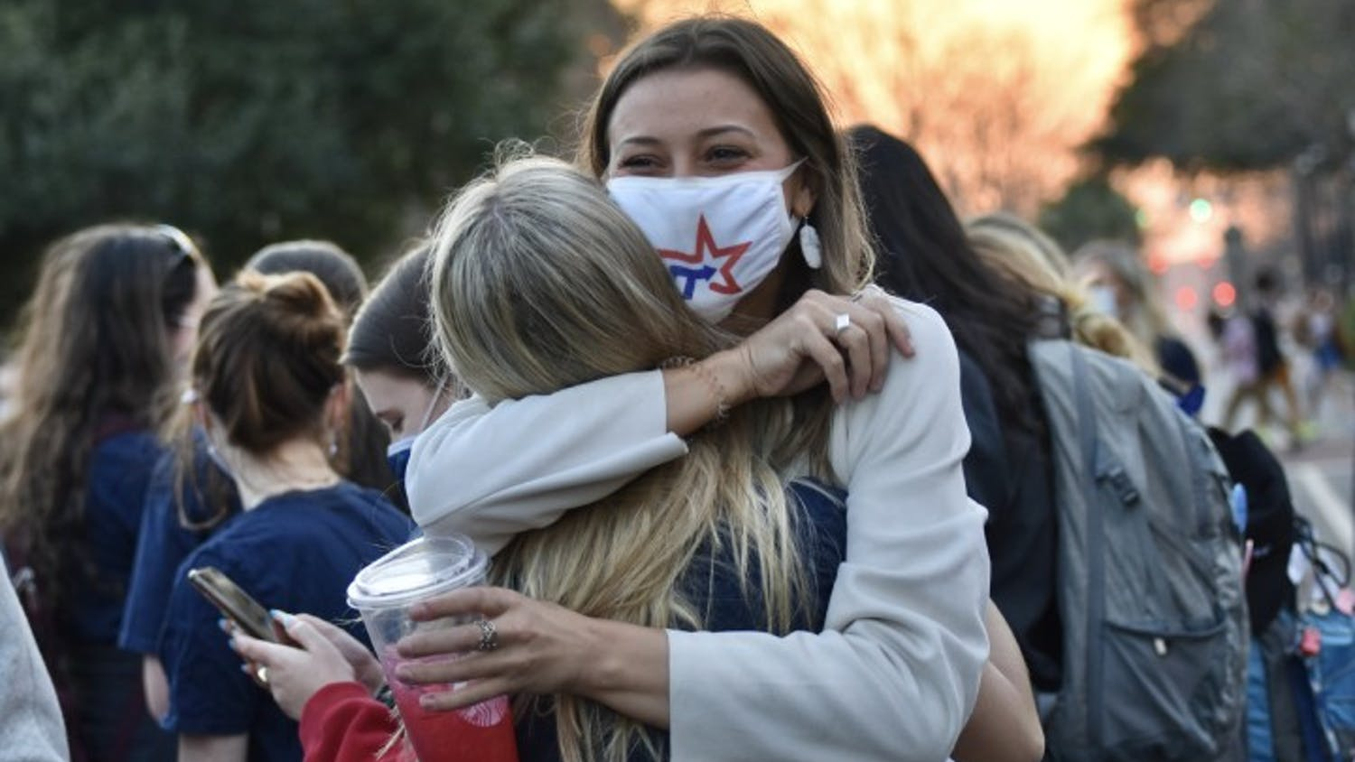 Candidate for treasurer, Kate Turner (right), embraces the new student body vice president-elect, Emily Dengler, after the announcement of the Student Government election results. The presidential and treasurer elections will go on to a runoff.
