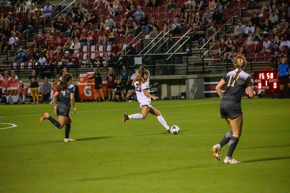 <p>Redshirt junior midfielder Samantha Chang tries to keep control of the ball away from two Vanderbilt players. The Gamecocks won 1-0 against Vanderbilt.</p>